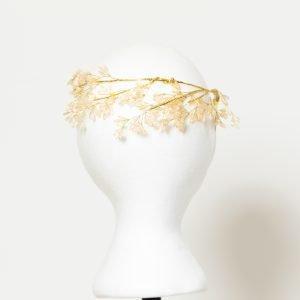 Diadema dorada con forma de hoja para invitada
